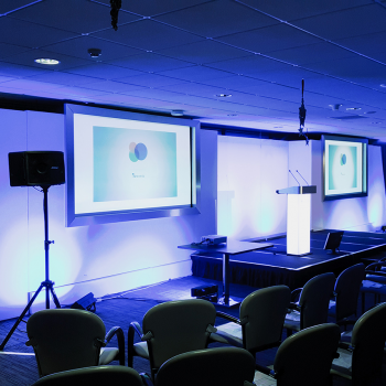 Using video conferencing for an event to link up two venues Cardiff and Llandudno